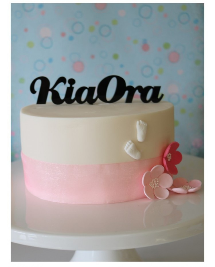 image: Black acrylic cake topper Kia Ora (wedding or party)