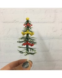 image: Plastic Christmas tree cake topper white tipped pine tree